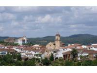 Why is the town of Jabugo known as the cot of Iberian ham?