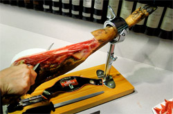cut into slices of spanish iberian iberico bellota serrano pata negra ham