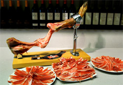 cut into slices of spanish iberian iberico bellota serrano pata negra shoulder ham